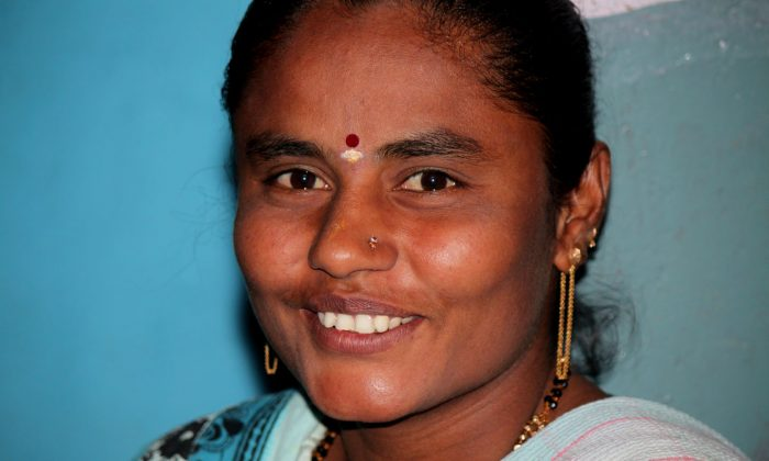 One of the member of the self-help group, Adishakti Mahila Group, sits during their monthly meeting, on December 11, 2013, at Lakshmidevi Nagar slums in Bangalore, India. With no social security and options for financial assistance the micro-financing activity is a great help to these women. (Venus Upadhayaya/Epoch Times)
