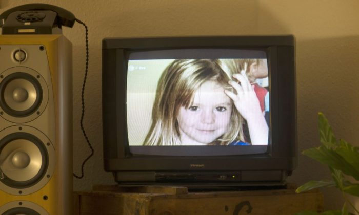 Photo of British girl Madeleine McCann, AKA Maddie is displayed on a TV screen at an apartment in Berlin, Germany, on Oct. 16, 2013 during the broadcast of German ZDF's 'Aktenzeichen XY' program. (JOHANNES EISELE/AFP/Getty Images)
