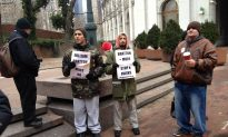 Protesters Oppose the Return of Bill Bratton