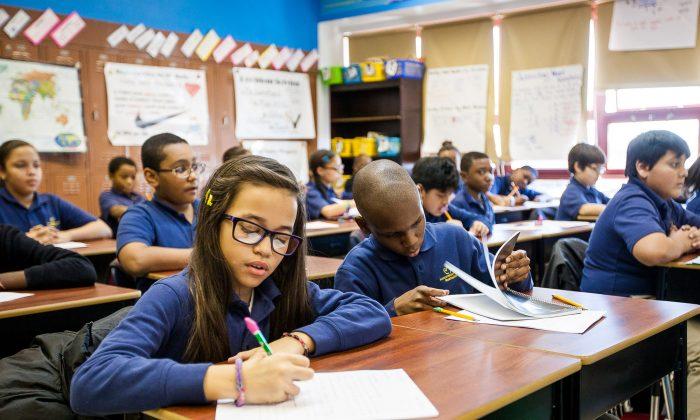 Fifth-grade students work during homeroom class at Achievement First Bushwick charter school in Brooklyn, New York, Jan 30, 2014. (Petr Svab/Epoch Times)