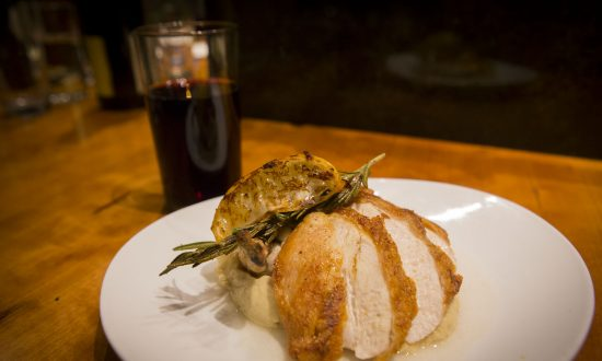 Crispy roasted organic chicken breast with fresh herbs and celery root purée, with organic Barbera wine. (Courtesy of Ellary's Greens)