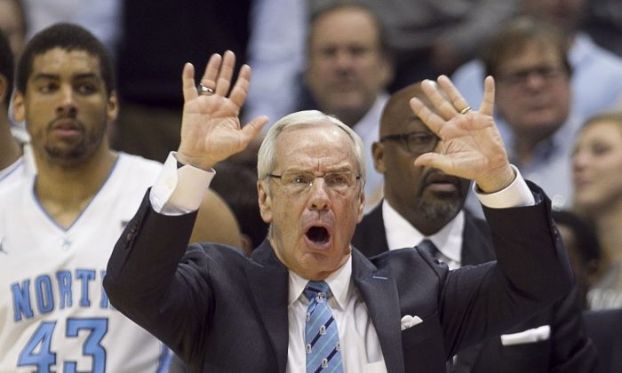 North Carolina's coach Roy Williams directs his team during the first half  of an NCAA basketball game, Tuesday, Feb. 4, 2014 at the Smith Center in Chapel Hill, N.C. (AP Photo/The News & Observer, Robert Willett)