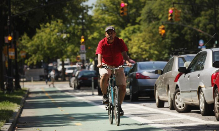 A man rides his bike along a bike lane on Prospect Park West on August 17, 2011 in the Brooklyn borough of New York City. (Spencer Platt/Getty Images)