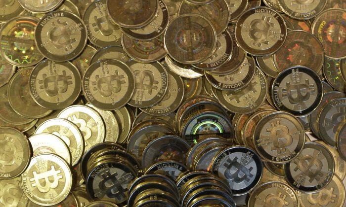 This file photo shows bitcoin tokens in Sandy, Utah. (AP Photo/Rick Bowmer, File)