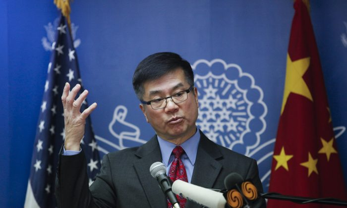 U.S. Ambassador to China Gary Locke delivers his farewell speech at the Beijing American Center on Feb. 26, 2014 in Beijing. Locke said that Clinton is strong on human rights. (ChinaFotoPress/Getty Images)