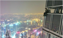 Chinese Copy Russian Daredevils' Scaling of Shanghai Tower