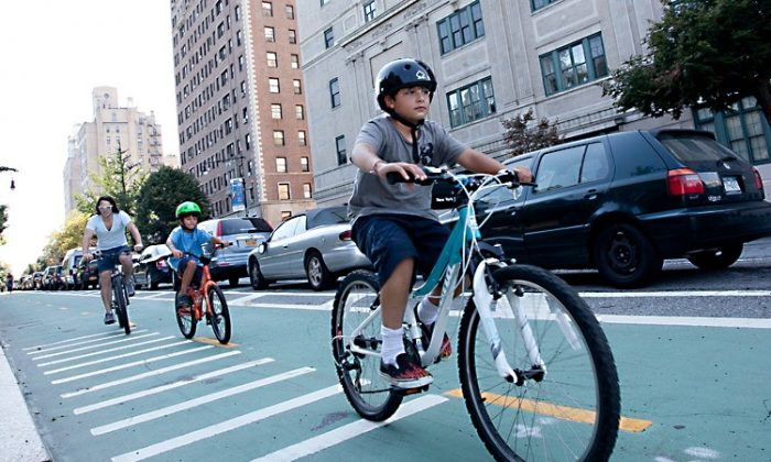 Cyclists ride near Grand Army Plaza in Brooklyn in this file photo. (Amal Chen/The Epoch Times)