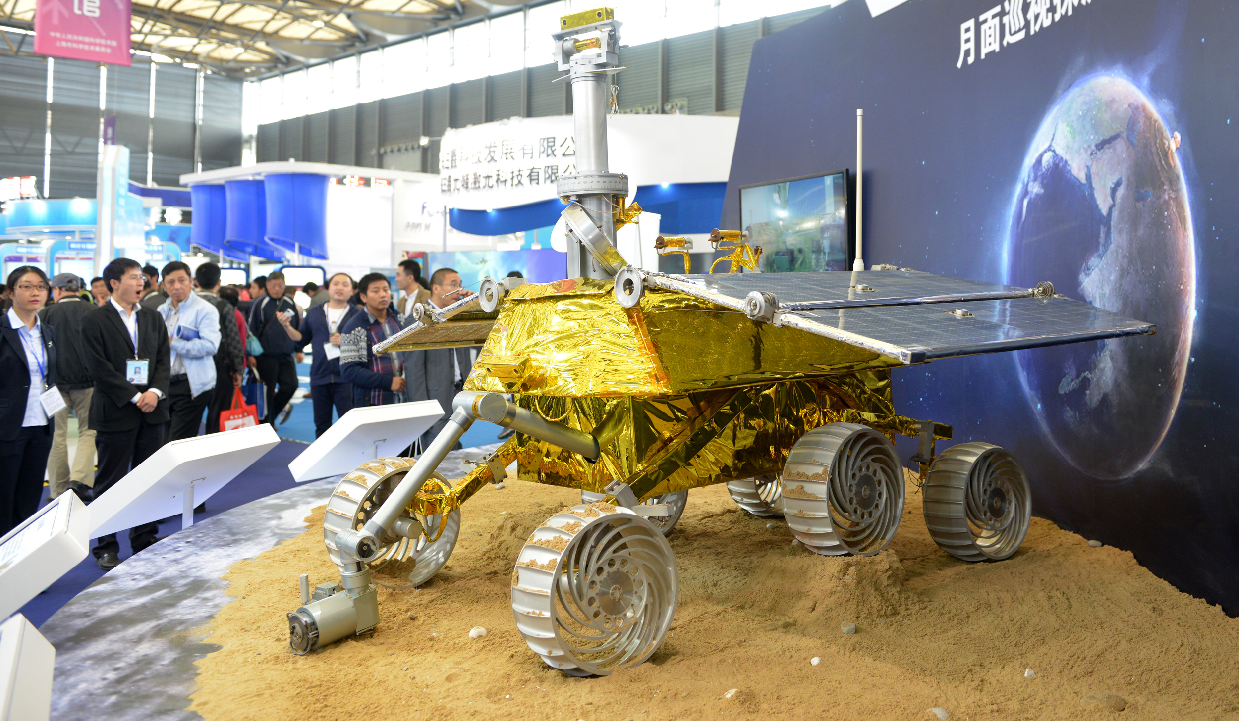 A model of China's moon rover, which recently malfunctioned on the moon, is shown in Shanghai on Nov. 5, 2013. Europe is shown being nuked in an artistic rendition of the Earth used in the display. (Peter Parks/AFP/Getty Images)