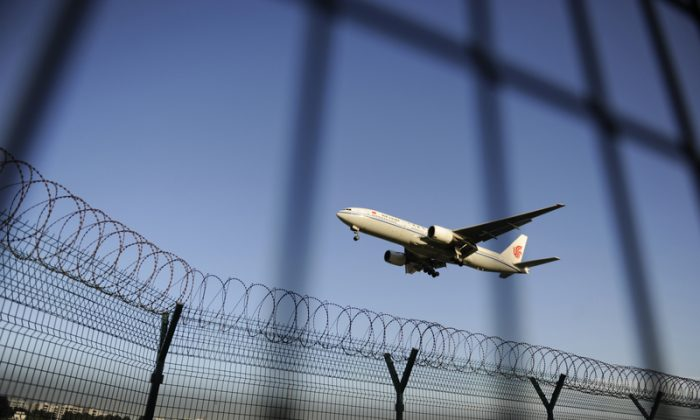 An Air China plane prepares to land at Beijing Capital International airport on Sept. 4, 2012. (WANG ZHAO/AFP/GettyImages)