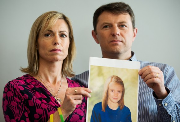 Parents of missing girl Madeleine McCann, Kate and Gerry McCann pose with an artist's impression of how their daughter might look now at the age of nine ahead of a press conference in central London on May 2, 2012, five years after Madeleine's disappearance while on a family holiday in Portugal. (AFP/Getty Images)
