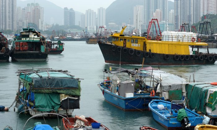 Boats are anchored in Hong Kong's Aberdeen Harbor, Sept. 22, 2013. Chinese companies have used Hong Kong banks to trade paper warrants for copper, which is often stashed in warehouses in transit to China. (RICHARD A. BROOKS/AFP/Getty Images)