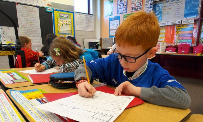 Pupils practice cursive writing on Oct. 15, 2013 at Triadelphia Ridge Elementary School in Ellicott City, Maryland.  (Robert MacPherson/AFP/Getty Images)