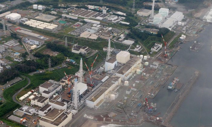 This aerial file photo taken in Aug. 2013,  shows No 4, 3, 2, 1, 5 and 6 reactors, from bottom to top, at the Fukushima Daiichi nuclear power plant in Futaba town, Fukushima Prefecture, northeastern Japan.   (AP Photo/Kyodo News, File)