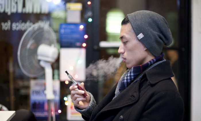 A customer at the e-cigarettes shop VapeNY in the Lower East Side of Manhattan, New York, on Dec. 19, 2013. (Samira Bouaou/Epoch Times)
