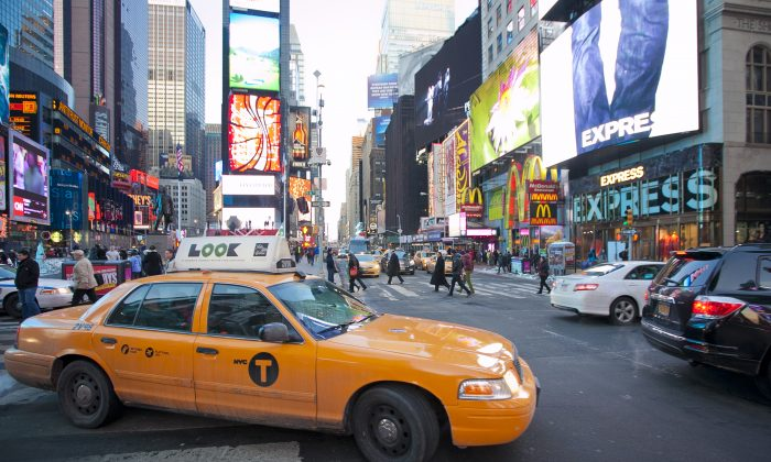 A taxi in Times Square at Broadway and 46 Street in New York, Feb. 10, 2014. (Samira Bouaou/Epoch Times)