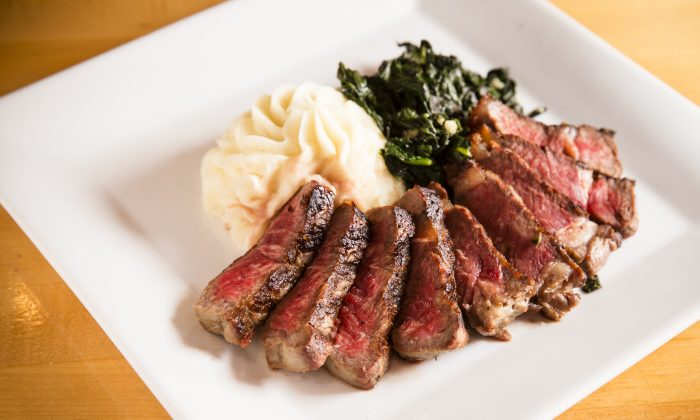 New York strip steak, with mashed potatoes and sauteed spinach. (Edward Dai/Epoch Times)