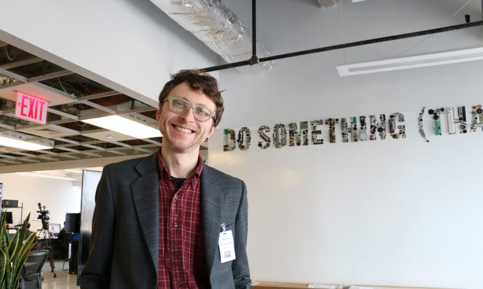 Alex Pasternack, co-founder of Bandwagon, at his desk in the Urban Future Lab at 15 MetroTech Center, Brooklyn, New York, March 13, 2014. (Allen Xie)