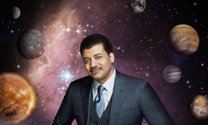 """This photo released by Fox shows Neil deGrasse Tyson, the astrophysicist who hosts the television show, """"Cosmos: A Spacetime Odyssey,"""" which premiered Sunday, March 9, 2014 on Fox and simultaneously across multiple U.S. Fox networks. The series explores how we discovered the laws of nature and found our coordinates in space and time.  (AP Photo/Fox, Patrick Eccelsine)"""
