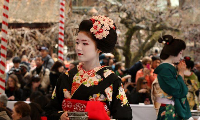 Japanese Geisha holds green tea cups during the annual Baikasai, Plum Blossom Festival at Kitano Tenmangu Shrine on Feb. 25, 2014 in Kyoto, Japan. Being a Geisha doesn't come cheap. (