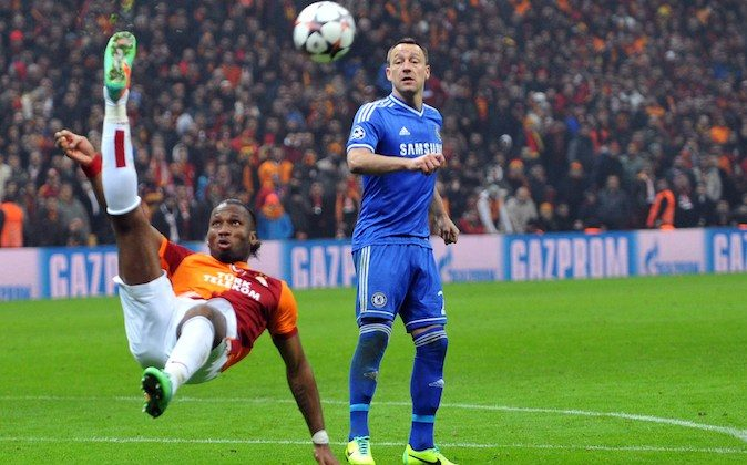 Galatasaray's Ivorian forward Didier Drogba (L) kicks the ball in front of Chelsea's British defender John Terry (R) during the UEFA Champions League round of 16 football match between Galatasaray and Chelsea on February 26, 2014 at the TT Arena Stadium in Istanbul.  (OZAN KOSE/AFP/Getty Images)