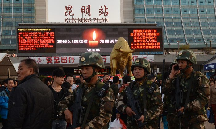 Chinese paramilitary police patrol the main train station in Kunming, Yunnan Province, on March 3, 2014, after knife-wielding assailants left at least 29 people dead. (Mark Ralston/AFP/Getty Images)