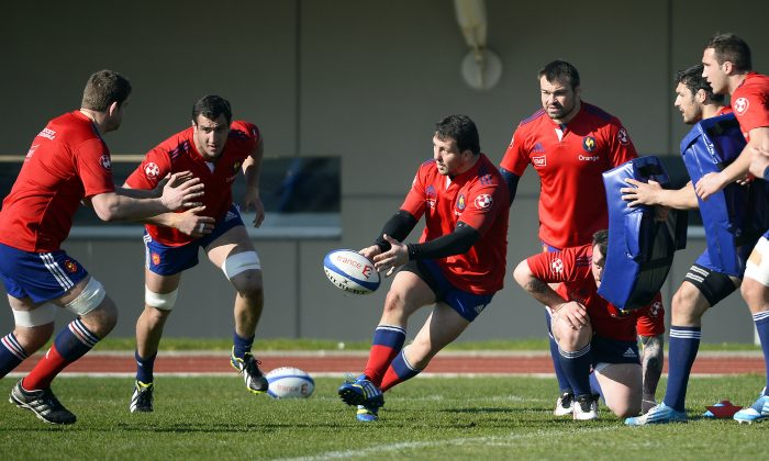 rance's rugby union national team player Brice Mach (C) passes the ball while taking part in a training session on March 6, 2014 in Marcoussis, outside Paris, two days ahead of a Six Nations match against Scotland. (Lionel Bonaventure/AFP/Getty Images)