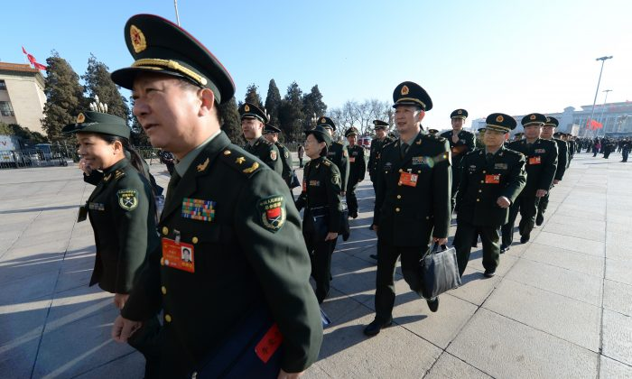 Military delegates arrive for the closing ceremony of the Chinese National People's Congress (NPC) at the Great Hall of the People in Beijing on March 13. Xi Jinping, the Party leader, has appointed himself head of a new committee on military reform. (Goh Chai Hin/AFP/Getty Images)
