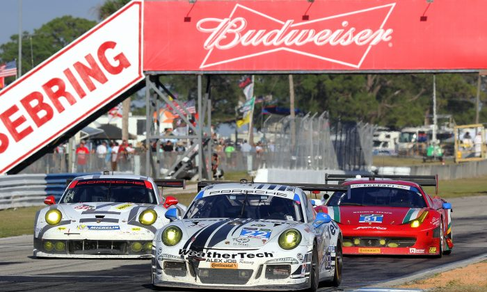 The #23 Weather Tech/AJR Porsche leads the #912 PNA Porsche (L) and the #51 Spirit of Racing Ferrari 458 (not the one involved in the incident.) (Chris Jasurek/Epoch Times)