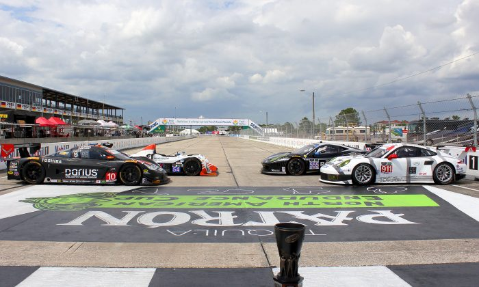 (Clockwise from front left) The #10 Wayne Taylor Racing Coyote-Corvette Prototype, the PC-class #54 Core Autosport Oreca-Chevrolet, the #555 GTD Level 5 Ferrari, and the #911 GTLM Porsche North America RSR, the four NAEC leaders heading into the Sebring 12 Hours. (Chris Jasurek/Epoch Times)