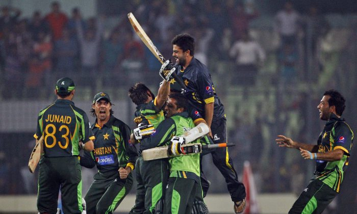 Pakistan''s team celebrates after winning the Asia Cup one-day international cricket tournament against India in Dhaka, Bangladesh, Sunday, March 2, 2014. Pakistan won by 1 wicket. (AP Photo/A.M. Ahad)