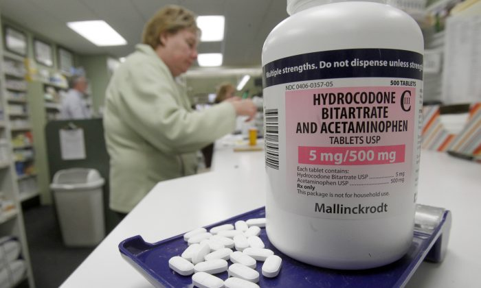 Hydrocodone pills, also known as Vicodin, at a pharmacy in Montpelier, Vt., on Feb. 19, 2013. Drug overdose deaths rose for the 11th straight year, federal data show, and most of them were accidents involving addictive painkillers despite growing attention to risks from these medicines. As in previous recent years, opioid drugs—which include OxyContin and Vicodin—were the biggest problem, contributing to 3 out of 4 medication overdose deaths. (AP Photo/Toby Talbot)