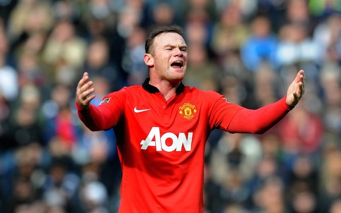 Manchester United's Wayne Rooney shouts instructions to team mates during the English Premier League soccer match between West Bromwich Albion and Manchester United at The Hawthorns Stadium in West Bromwich, England, Saturday, March 8, 2014. (AP Photo/Rui Vieira)