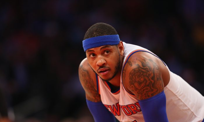 Carmelo Anthony led the league in scoring in 2012, but is part of a struggling Knicks team this year. (Al Bello/Getty Images)