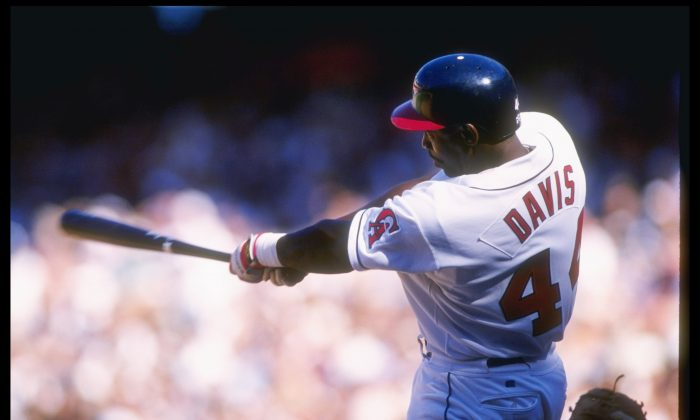 'Chili' Davis, whose real name is Charles, of the California Angels swings at the ball during a game against the Minnesota Twins at Anaheim Stadium in Anaheim, California. The Twins won the game 9-8. (J.D. Cuban /Allsport/Getty Images)