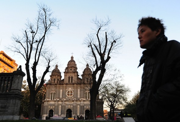 Shanghai Bishop Joseph Fan Zhongliang, of the unapproved Roman Catholic Church, died Sunday at age 97, under house arrest since 2002. Here, a man walks past the state-sanctioned St. Joseph's Catholic Cathedral in Beijing. There are two Catholics churches in China: the officially sanctioned, Communist Party-controlled one, and an unofficial 'clandestine' Roman Catholic Church that is loyal to the pope and the Vatican. (Frederic J. Brown/AFP/Getty Images)