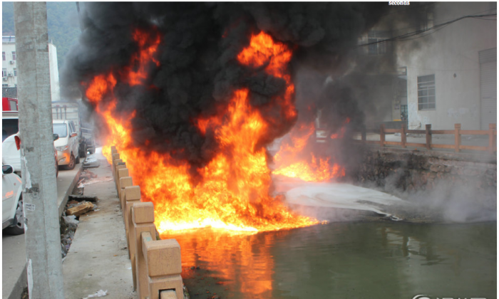Screenshot showing a section of the Meiyu River on fire in Zhejiang Province. The blaze was thought to be due to pollution from a shoe-making factory that caught fire when a lit cigarette was thrown into the water. (Screenshot/Wenzhou News)