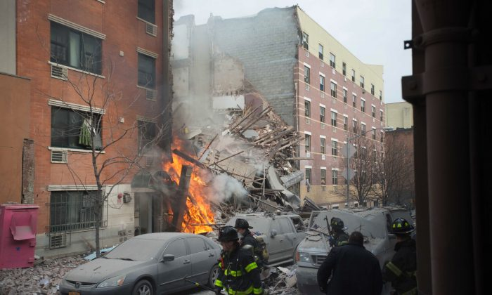Firefighters work the scene of an explosion that leveled two apartment buildings in the East Harlem neighborhood of New York, Wednesday, March 12, 2014. (Jeremy Sailing/AP)