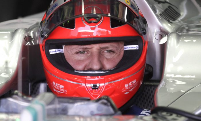 Michael Schumacher, of Germany, sits in his car during a free practice at the Interlagos race track in Sao Paulo, Brazil. (AP Photo/Victor Caivano, File)