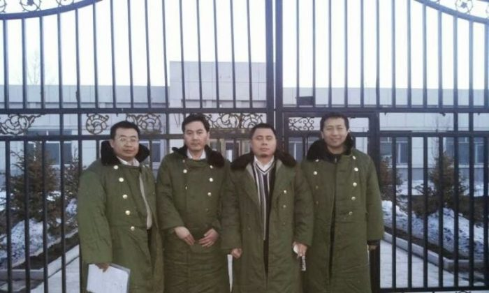 Mainland human rights lawyers (L–R) Jiang Tianyong, Tang Jitian, Wang Cheng, and Zhang Junjie stand outside a brainwashing center before being arrested. They are still in custody. (Courtesy of the subjects)