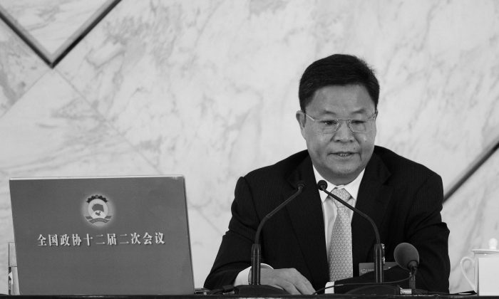 Lü Xinhua, an official spokesman, attends a press conference at the Great Hall of the People in Beijing on March 2, 2014. Lü all but acknowledged that Zhou Yongkang, the former security czar, is in trouble. (Wang Zhao/AFP/Getty Images)