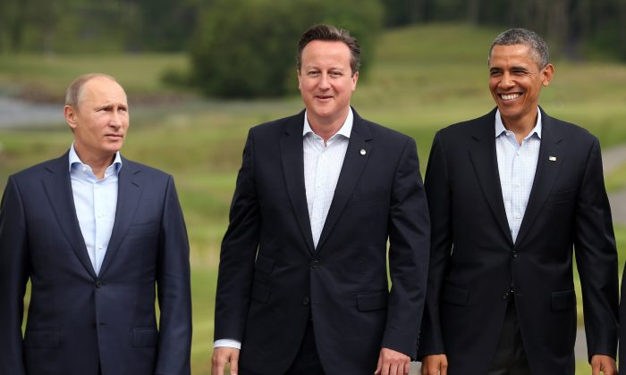 Russia's President Vladimir Putin (L), Britain's Prime Minister David Cameron (C), U.S. President Barack Obama at the G-8 in Enniskillen, Northern Ireland, on June 18, 2013. (Matt Cardy/Getty Images)