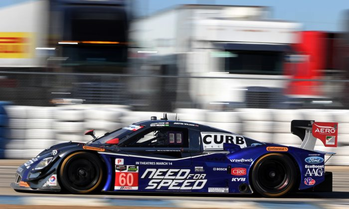 IndyCar star Justin Wilson, driving the #60 Michael Shank Racing Riley-Ford, completed the 17-turn lap of the 3.74-mile Sebring Raceway in 1:53.621, the quickest time of the Thursday afternoon practice session for the Sebring 12 Hours. (Chris Jasurek/Epoch Times)