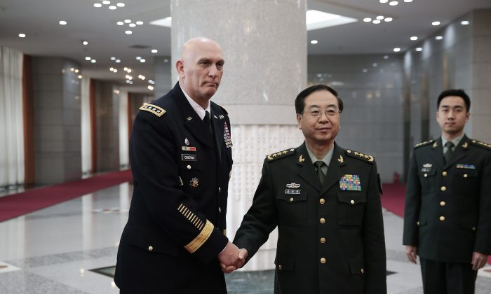 U.S. Army Chief of Staff General Ray Odierno (L) meets with China's Chief of the General Staff of the People's Liberation Army Fang Huifeng, at Bayi Building in Beijing on Feb. 21. China plans to increase military spending in 2014, following a two-decade trend. (LINTAO ZHANG/AFP/Getty Images)
