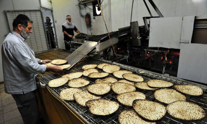 Orthodox Jewish men prepare hand-made glat kosher matzah in Jerusalem, Israel. (*Shutterstock)
