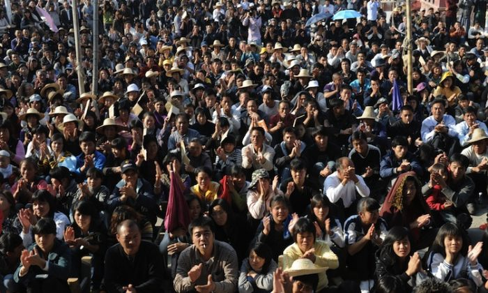 Wukan villagers listen to a speech by village leader Lin Zuluan in Wukan, Guangdong Province, Dec. 21, 2011, prior to democratic elections. Village chief Lin Zuluan has angered other elected village officials with lack of transparency in conducting village committee business, and not informing them that fired Party bosses had been re-appointed. (Mark Ralston/AFP/Getty Images)