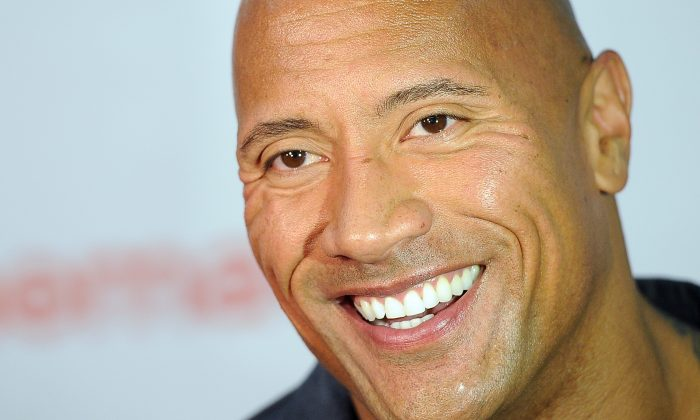 """Dwayne Johnson, star of the upcoming film """"Hercules,"""" is interviewed before the Opening Night Presentation from Paramount Pictures at CinemaCon 2014 on Monday, March 24, 2014, in Las Vegas. (Photo by Chris Pizzello/Invision/AP)"""