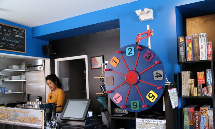Monopolatte customers can spin this wheel to help them decide which of the 800 available games to play. (Pam McLennan/Epoch Times)