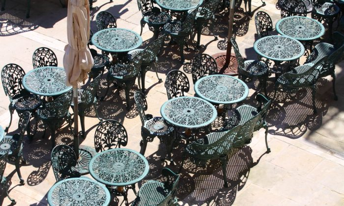 Green caffe chairs in the harbour of Valletta, Malta. (*Shutterstock)