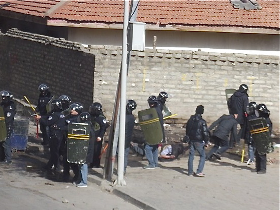 Police respond to a protest in Serta town, Sichuan Province, a partially-Tibetan populated area of China on Jan. 24, 2012. Chinese tourists are shocked at the militarization of Tibet, and their frank Internet posts show how the reality differs from official propaganda. (Students for a Free Tibet)