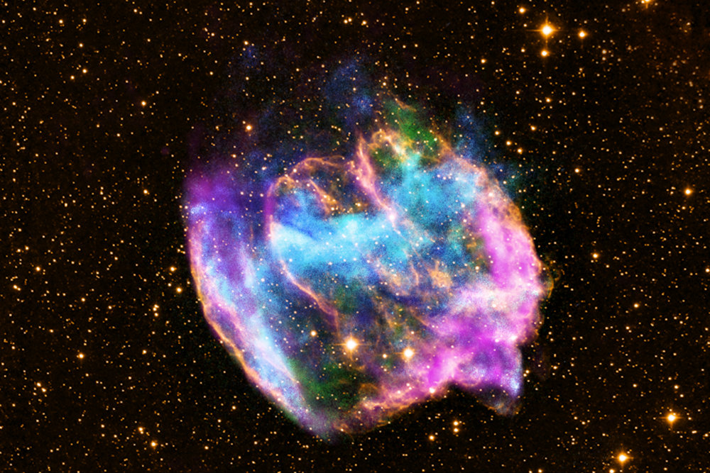 The highly distorted supernova remnant shown in this image may contain the most recent black hole formed in the Milky Way galaxy. The image combines X-rays from NASA's Chandra X-ray Observatory in blue and green, radio data from the NSF's Very Large Array in pink, and infrared data from Caltech's Palomar Observatory in yellow. The remnant, called W49B, is about a thousand years old, as seen from Earth, and is at a distance of about 26,000 light years away. (X-ray: NASA/CXC/MIT/L.Lopez et al.; Infrared: Palomar; Radio: NSF/NRAO/VLA)